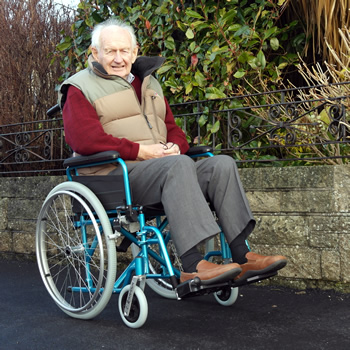 The old man sitting in a lightweight aluminium self propelled wheelchair